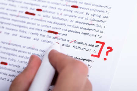 Human Hand Holding Red Marker During Spellchecking Text With Question Mark Sign