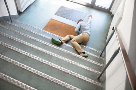 Unconscious Man Lying On Staircase After Slip And Fall Accident
