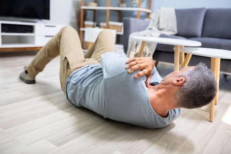 Man Fallen On Floor Having Pain Lying On Floor After Accident