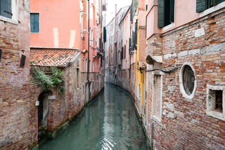 Historic Buildings Near Narrow Canal In Venice, Italy 版權商用圖片