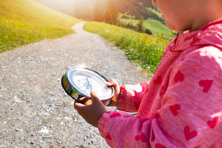 Girl Playing Geocaching Game In Mountains In Summer