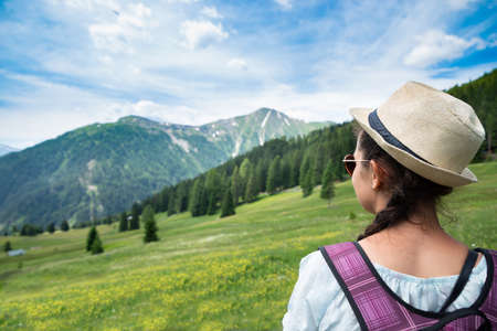 Woman With Backpack Enjoying Panoramic Mountain View