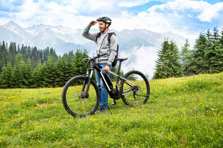 Main On Mountain With His Bike In Alps