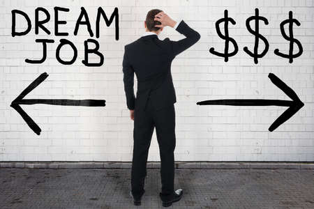 Doubtful Businessman Looking At Wall Showing Dream Job And Dollar Sign Directions Stockfoto