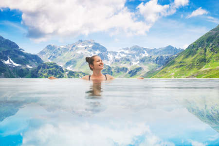 Photo Of Woman In Infinity Pool In Mountains