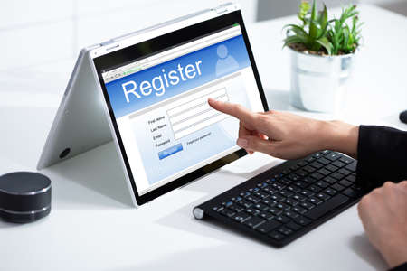 Businesswomans Hand Filing Online Registration Form On Laptop Stockfoto