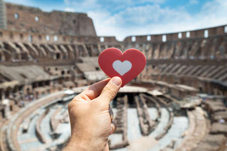 Man Holding Heart Shape Inside Of Colosseum, Italy