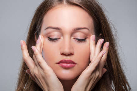 Woman Doing Face Fitness Exercises At Home