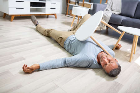 Man Fallen On Floor Having Pain Lying On Floor After Accident