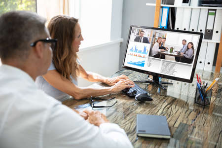 Mature Businessman Video Conferencing With His Colleague On Computer