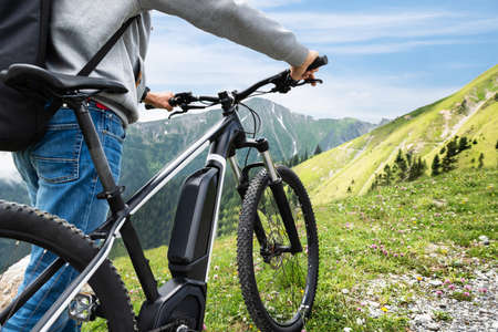 Main On Mountain With His Bike In Alps 写真素材