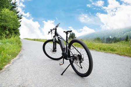 Electric Mountain Bike On Road In Austrian Mountains