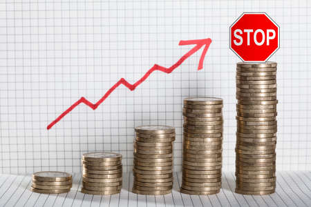 Red Stop Caution On Stack Of Coins Showing Growth In Profit Standard-Bild
