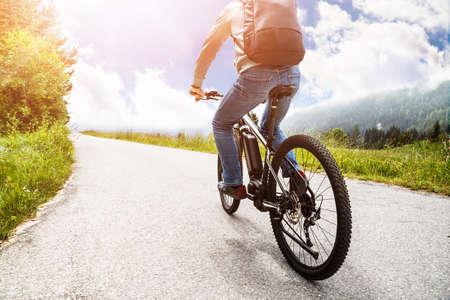 Man Riding Electric Mountain Bike In Alps Stock fotó
