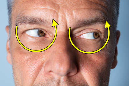 Man Doing Shifting Eye Exercise To Improve Vision