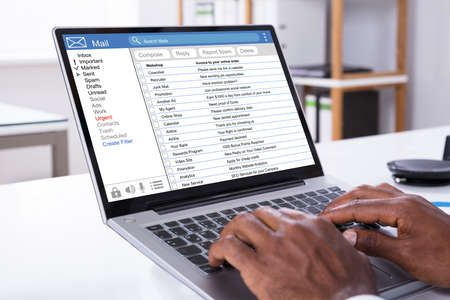 Close-up Of Woman Checking Mail Inbox On Laptop