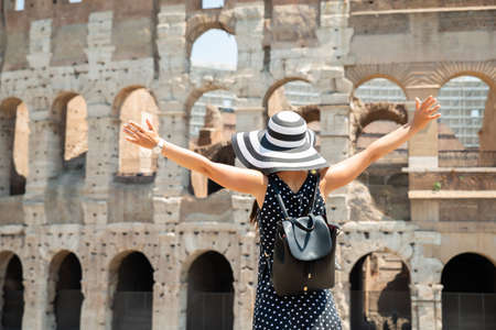 Woman Tourist Standing In Front Of Colosseum In Rome, Italy
