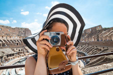 Woman Taking Photo Inside Of Colosseum In Rome, Italy 스톡 콘텐츠 - 129801496