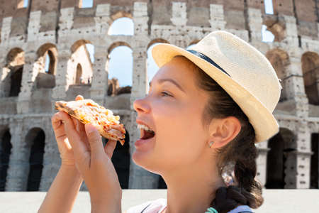 Woman Eating Italian Pizza Near Colosseum, Rome Stock Photo