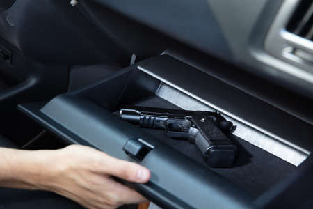 Driver Taking Handgun From Glovebox Compartment Inside Car Imagens