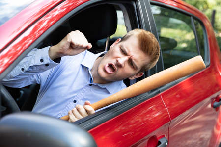 Angry Driver With Baseball Bat Screaming Out Of Car Window Banco de Imagens
