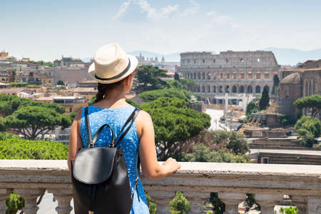 Rear View Of Female Tourist Looking At Roman Forum And Colosseum 写真素材