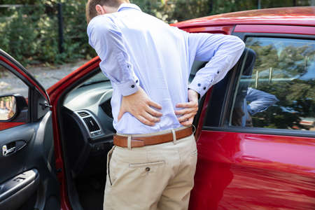 Driver Standing Having Backpain After Driving Car Stockfoto