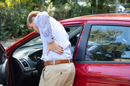 Driver Standing Having Backpain After Driving Car Zdjęcie Seryjne
