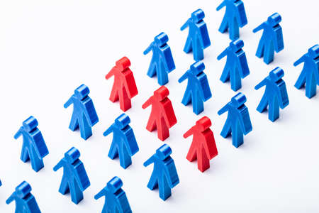 Elevated View Of Red Figures Stand With Blue Figures Group In A Row
