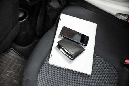 Mobile Phone And Laptop On Car's Seat