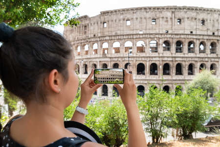 Woman Taking Photo Of Colosseum In Rome, Italy 스톡 콘텐츠