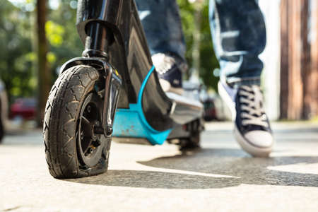 Man With Flat Tire On His E-Scooter