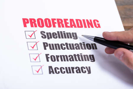 Proofreading Checklist Concept. Man Crossing Checkboxes At Desk