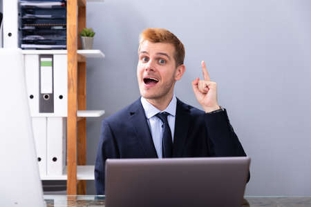 Businessman Having Ah Ha Moment While Working In Office On Laptop Stock fotó