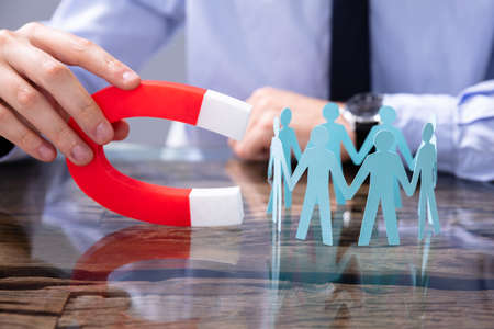 Businessperson Attracting Human Figures With Horseshoe Magnet Stok Fotoğraf