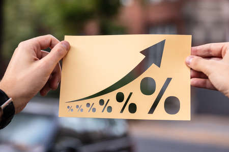 Hands Holding Paper With Cutout Percent Growth Outdoors Stockfoto