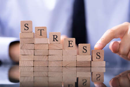 Reduce Stress Concept. Wooden Blocks In Declining Chart