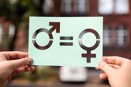 Hands Holding Paper With Cutout Gender Equality Outdoors Stockfoto