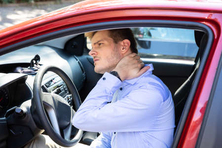 Driver Standing Having Neck Pain After Driving Car