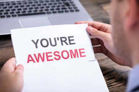 Man Opening White Envelope With You Are Awesome Text Stockfoto