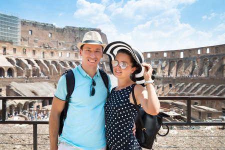 Young Tourist Couple Standing Inside Of Colosseum In Rome, Italy Фото со стока