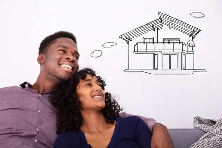 Happy Young Couple Dreaming About The Future Home Stock Photo