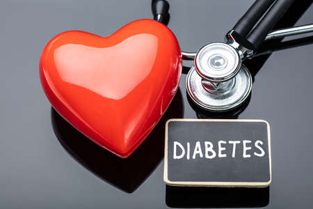 Diabetes, Stethoscope And Heart On Black Table Stok Fotoğraf