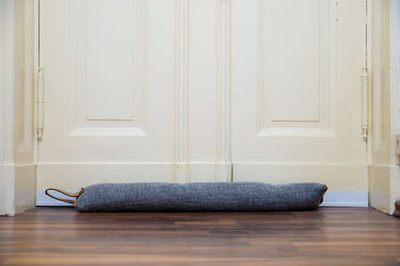 Draft Excluder Under Door Blocking Cold Air From Traveling Around Imagens
