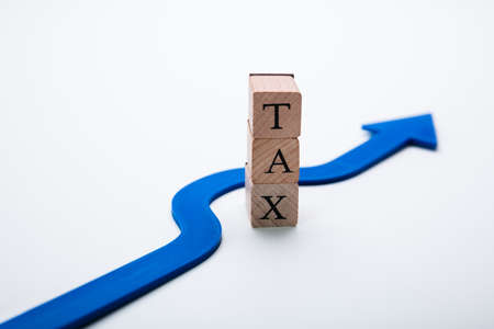 Arrow Going Around Word Tax In Tax Evasion Concept Stock Photo