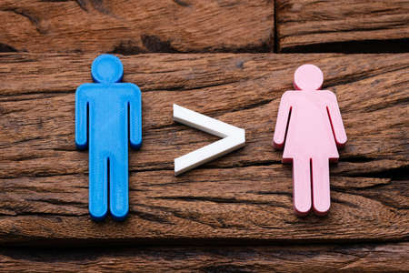 Photo Of Gender Inequality Concept Over Wooden Background