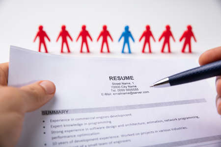 HR Manager Reading Resume Of Ideal Job Candidate Imagens