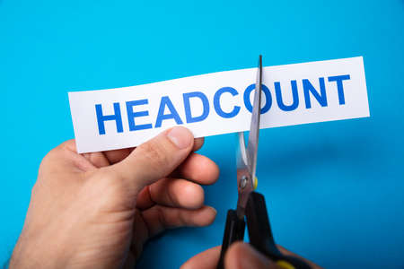 Person Cutting Headcount Using Scissors On Blue Background Stok Fotoğraf