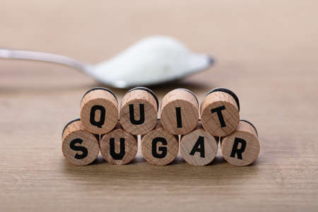 Quit Sugar Words Near Spoon Of Sugar On Table