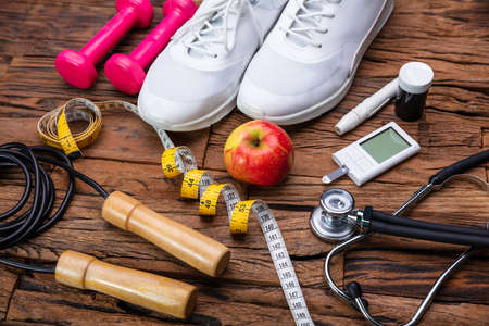 Blackboard with Diabetes Word Near Sports Equipment And Glucometer. Diabetes And Exercise Concept Stockfoto